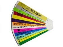 Custom printed Tyvek wristbands, security wristbands, paper wristbands, solid paper color with writing in black ink